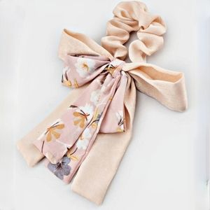 Ariane floral pony bow
